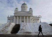 A woman walks past Helsinki cathedral March 4, 2011. REUTERS/Yves Herman