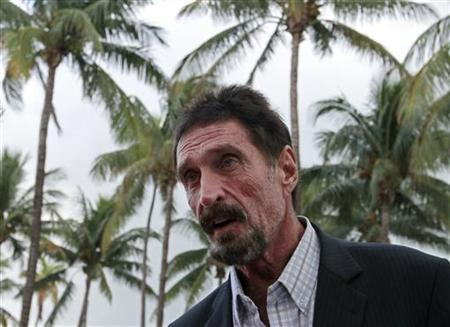 McAfee says will not return to Belize, willing to talk...