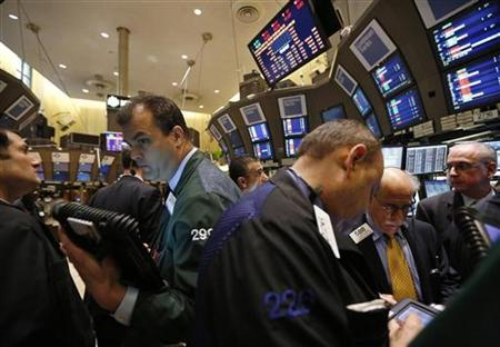 Traders work on the floor of the New York Stock Exchange, December 14, 2012. REUTERS/Brendan McDermid