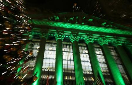 The New York Stock Exchange is seen lit up in green as part of Christmas preparations in New York, December 11, 2012. REUTERS/Carlo Allegri