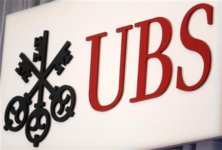 The UBS logo is seen at the UBS 40th Annual Global Media and Communications Conference in New York, December 5, 2012. REUTERS/Carlo Allegri