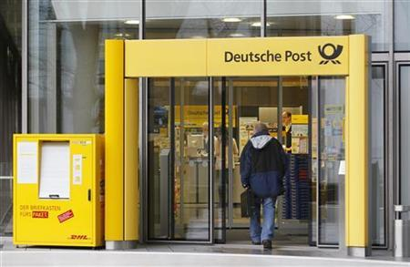 A man walks into a branch of German postal and logistics group Deutsche Post DHL in Bonn March 8, 2012. Deutsche Post DHL sees its sales and operating profit edging up this year, and continued growth in the coming years on the back of robust Asian demand for express delivery and supply chain services. REUTERS/Wolfgang Rattay (GERMANY - Tags: BUSINESS)