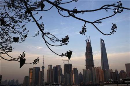 The financial district of Pudong is seen in Shanghai December 12, 2012. China's real estate investment rose 16.7 percent in the first 11 months of 2012 from the same period a year earlier, up from an annual increase of 15.4 percent in the first 10 months, the National Bureau of Statistics said. REUTERS/Carlos Barria (CHINA - Tags: BUSINESS REAL ESTATE)