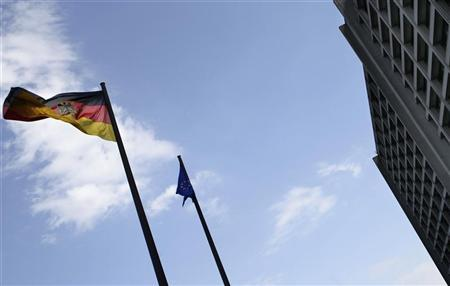 A German flag and a European Union flag flutter in front of the headquarters of the German central bank (Bundesbank) in Frankfurt, May 2, 2011. REUTERS/Kai Pfaffenbach
