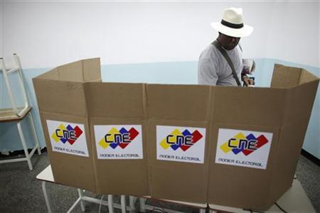 A man casts his ballot during a governors election in Caracas December 16, 2012. REUTERS/Jorge Silva
