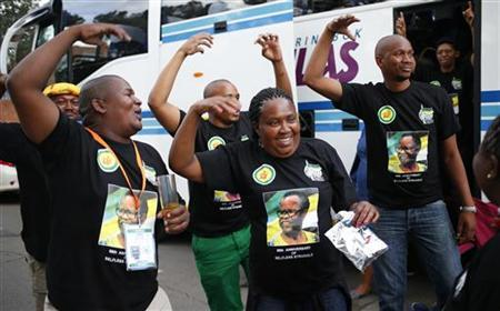 Delegates to the 53rd National Conference of the ruling African National Congress (ANC) sing and dance in the streets of Bloemfontein, December 15, 2012. REUTERS/Mike Hutchings