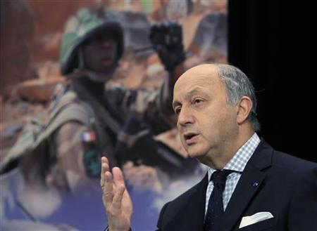French Foreign Minister Laurent Fabius holds a news conference at NATO headquarters after a meeting of NATO foreign ministers in Brussels December 4, 2012. REUTERS/Yves Herman