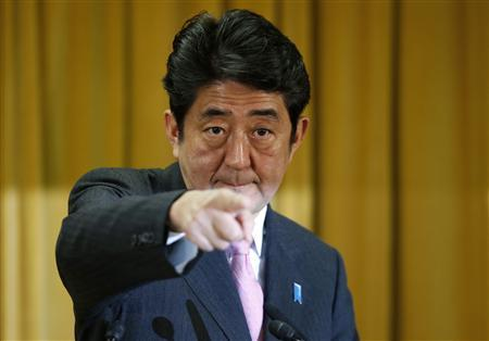 Japan's conservative Liberal Democratic Party's (LDP) leader and next Prime Minister Shinzo Abe points during a news conference at the LDP headquarters in Tokyo December 17, 2012. REUTERS/Toru Hanai