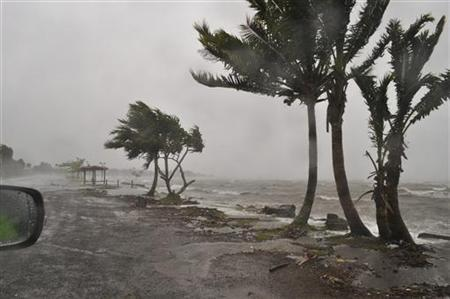 Strong waves caused by Cyclone Evan wash a beach in Queen Elizabeth Drive, in Suva in this handout picture taken December 17, 2012. REUTERS/Fiji Ministry of Information/Handout