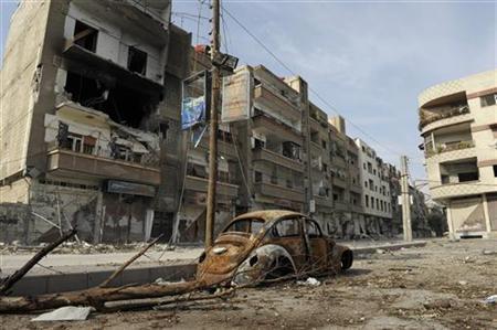 A burnt car is seen on a damaged street in Daraya near Damascus December 16, 2012. REUTERS/Hussam Chamy