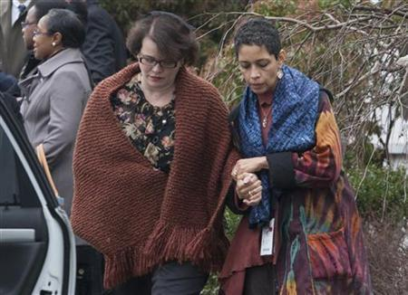 Veronique Pozner (L) leaves after the funeral services for her son Noah Pozner in Fairfield, Connecticut December 17, 2012. REUTERS/Michelle McLoughlin