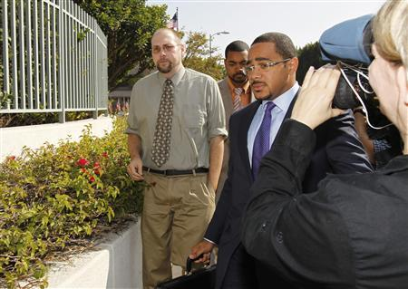Christopher Chaney (L) arrives for a post-indictment arraignment at Edward R. Roybal Federal Building in Los Angeles in this November 1, 2011, file photo. REUTERS/Mario Anzuoni/Files