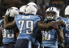 Tennessee Titans' safety Michael Griffin (33) celebrates after intercepting a pass in the end zone intended for New York Jets' tight end Jeff Cumberland (not pictured) in the second half of their NFL Monday Night football game in Nashville, Tennessee December 17, 2012. REUTERS/Harrison McClary