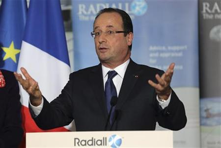 French President Francois Hollande delivers a speech as he visits the Radiall engineering and coaxial connectors plant in Chateau-Renault, central France, December 17, 2012. REUTERS/Philippe Wojazer