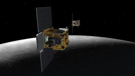 An artist's depiction shows the twin spacecraft (Ebb and Flow) that comprise NASA's Gravity Recovery And Interior Laboratory (GRAIL) mission. A pair of NASA moon-mapping probes smashed themselves into a lunar mountain on December 17, 2012, ending a year-long mission that is shedding light on how the solar system formed. REUTERS/NASA/JPL-Caltech/MIT/Handout