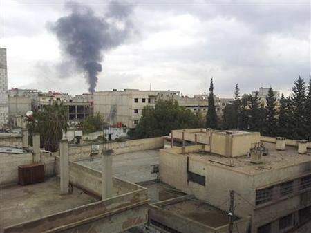 Smoke rises after what activists said were shelling by forces loyal to Syrian President Bashar al-Assad at Erbeen near Damascus December 8, 2012. REUTERS/Ahmed el-Erbeeni/Shaam News Network/Handout