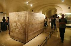 Visitors walk near the sarcophagus of Ramses III in the Egyptian gallery of the Louvre Museum in Paris, August 6, 2007. REUTERS/Regis Duvignau