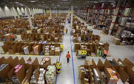 Work is carried out at Amazon's logistics centre in Graben near Augsburg December 17, 2012. REUTERS/Michael Dalder (GERMANY - Tags: BUSINESS)