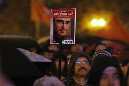 A participant holds a placard showing an image of a imprisoned tycoon Mikhail Khodorkovsky during a commemoration of victims of political repression in Moscow October 30, 2012. REUTERS/Maxim Shemetov
