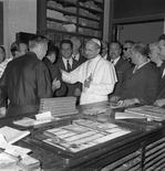 File photo of Pope Paul VI during a visit to the Osservatore Romano newspaper released July 4, 2011. Picture taken taken July 4, 1963. REUTERS/Osservatore Romano