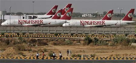 Kingfisher Airlines' passenger jets are seen parked at an airport in New Delhi April 12, 2012. REUTERS/Parivartan Sharma