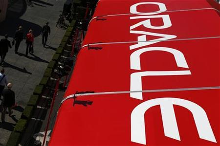 Pedestrians walk past an Oracle tent during Oracle OpenWorld 2012 in San Francisco, California October 1, 2012. REUTERS/Stephen Lam/Files