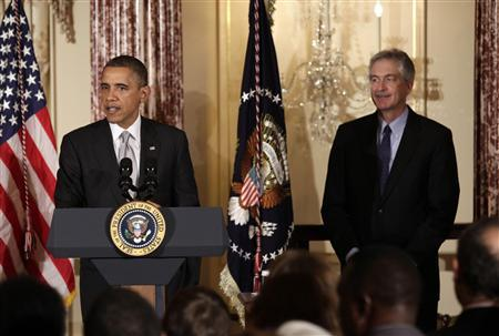U.S. President Barack Obama delivers remarks next to Deputy Secretary of State William Burns at the Diplomatic Corps holiday reception at the State Department in Washington December 19, 2012. REUTERS/Yuri Gripas