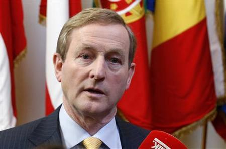 Ireland's Prime Minister Enda Kenny talks to the media after a European Union leaders summit in Brussels December 14, 2012. REUTERS/Francois Lenoir (BELGIUM - Tags: POLITICS BUSINESS)