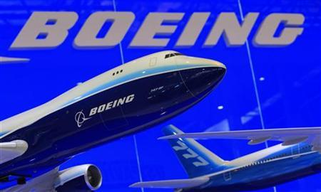 Models of Boeing 747 and 777 passenger planes are displayed at the Boeing booth as part of the China International Aviation & Aerospace Exhibition in the southern Chinese city of Zhuhai November 12, 2012, one day before its official opening on Tuesday. REUTERS/Bobby Yip