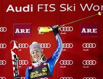 Mikaela Shiffrin of the U.S. celebrates on the podium after winning the FIS Alpine Ski World Cup women's slalom in Are, December 20, 2012. REUTERS/Pontus Lundahl/Scanpix