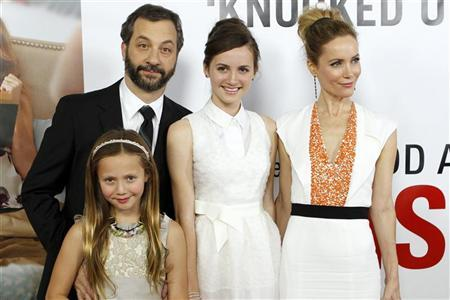 Writer/director/producer Judd Apatow arrives with his family and cast members (from L) Iris Apatow, Maude Apatow and Leslie Mann at the premiere of the movie ''This is 40'' at Grauman's Chinese Theatre in Hollywood, California December 12, 2012. REUTERS/Patrick T. Fallon