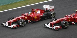 Ferrari Formula One driver Fernando Alonso of Spain (L) drives ahead of team mate Felipe Massa of Brazil during the Brazilian F1 Grand Prix at Interlagos circuit in Sao Paulo November 25, 2012. REUTERS/Ricardo Moraes