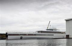 The superyacht built for Apple co-founder Steve Jobs is seen in a shipyard in Aalsmeer in this October 30, 2012 file photo. The superyacht has been impounded in Amsterdam because of a dispute over an unpaid bill to designer Philippe Starck, a lawyer said on December 21, 2012. REUTERS/Michael Kooren/Files