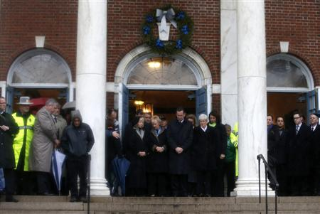 Connecticut Governor Daniel Malloy stands with others on the steps of the Edmond Town Hall in the center of Newtown, Connecticut during a moment of silence and ringing of church bells at 9:30am EDT for the victims of the December 14 shootings at the Sandy Hook Elementary school in Newtown, Connecticut, December 21, 2012. REUTERS/Mike Segar