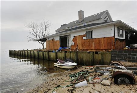 A home is seen damaged from Hurricane Sandy in Lindenhurst, New York December 4, 2012. REUTERS/Shannon Stapleton