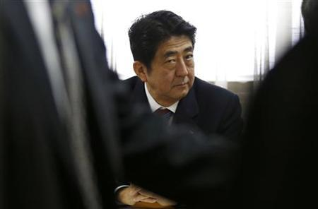 Shinzo Abe, Japan's incoming Prime Minister and the leader of Liberal Democratic Party (LDP), attends a meeting at the LDP headquarters in Tokyo December 21, 2012. REUTERS/Toru Hanai/Files