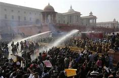 Police use water cannons to disperse demonstrators near the presidential palace during a protest rally in New Delhi December 22, 2012. Indian police used batons, tear gas and water cannon to turn back thousands of people marching on the presidential palace on Saturday in intensifying protests against the gang-rape of a woman on the streets and on social media. REUTERS/Adnan Abidi