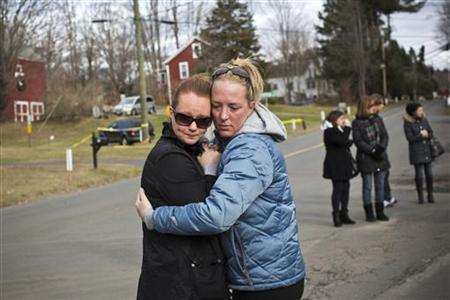 Two women embrace during a moment of silence at a memorial for those killed in the massacre at Sandy Hook Elementary School in Sandy Hook, Connecticut, December 23, 2012. REUTERS/Andrew Burton