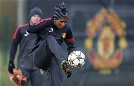 Manchester United's Ashley Young controls a ball during a training session at the club's Carrington training complex in Manchester, northern England December 4, 2012. REUTERS/Phil Noble