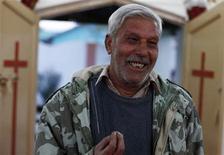 Pastor Nazir Alam smiles as he talks to a journalist at a church in South Waziristan November 28, 2012. REUTERS/Faisal Mahmood