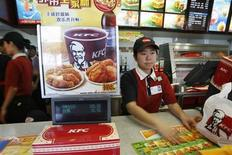 A KFC worker attends to a customer at a KFC outlet in Beijing April 2, 2007. REUTERS/Claro Cortes IV
