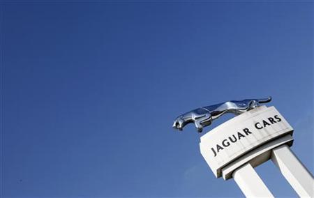 A Jaguar symbol is seen outside the Jaguar Land Rover's Halewood assembly plant in Liverpool, northern England, March 2, 2011. REUTERS/Phil Noble/Files