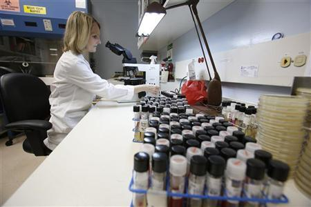 Tonya Snyder, a Mycology Specialist in the Vanderbilt Clinical Microbiology Lab for patient care examines samples to isolate and identify specimens for growth in Nashville, Tennessee on October 19, 2012. REUTERS/Harrison McClary