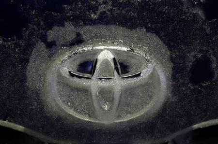 A Toyota logo covered with ice is seen on a HiAce van in Nasu, north of Tokyo December 8, 2012. A high-ranking Toyota Motor Corp executive believes that it will take the automaker a year to recover from the effects of a diplomatic row between Japan and China, the Kyodo news agency reported on Friday. REUTERS/Kim Kyung-Hoon (JAPAN - Tags: TRANSPORT BUSINESS LOGO ENVIRONMENT)