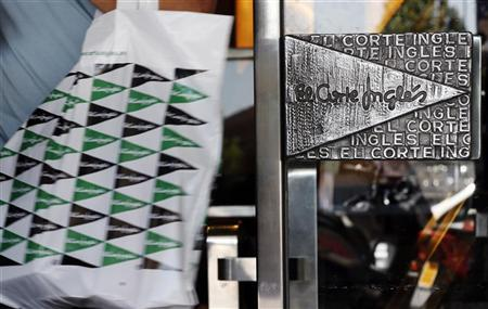 A customer leaves an El Corte Ingles department store in Madrid August 27, 2012. REUTERS/Sergio Perez