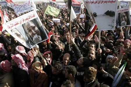 Protesters take part in a demonstration in Ramadi, 100 km west of Baghdad, December 26, 2012. The banner (bottom left) reads, ''Female prisoners ask loudly, 'Where is the anger of honourable people?''' REUTERS/Stringer