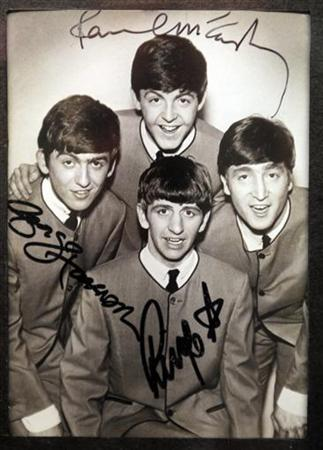 An autographed photo of The Beatles is displayed at an exhibition in Buenos Aires October 4, 2010. REUTERS/Enrique Marcarian/Files