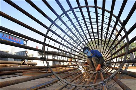 A worker welds steel bars at a construction site for a new train station in Ningbo, Zhejiang province, December 6, 2012. REUTERS/China Daily