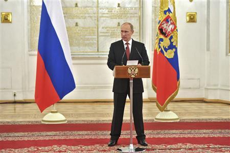 Putin signs ban on U.S. adoptions of Russian children