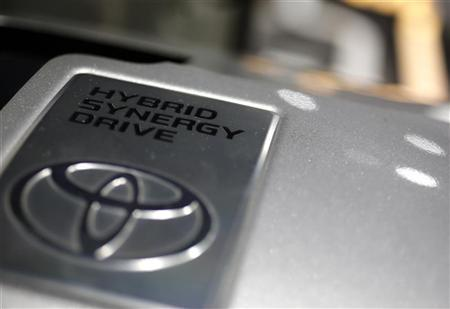 Toyota Motor Corp's logo is pictured on a power control unit displayed at Toyota Automobile Museum in Nagakute, central Japan November 28, 2012. REUTERS/Yuriko Nakao